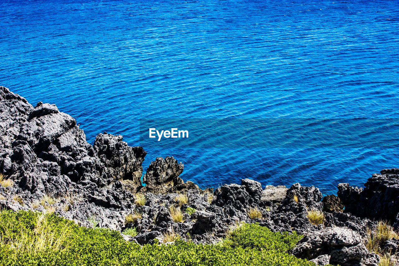 rock - object, water, blue, nature, sea, no people, outdoors, beauty in nature, day, tranquility, tranquil scene, scenics, grass