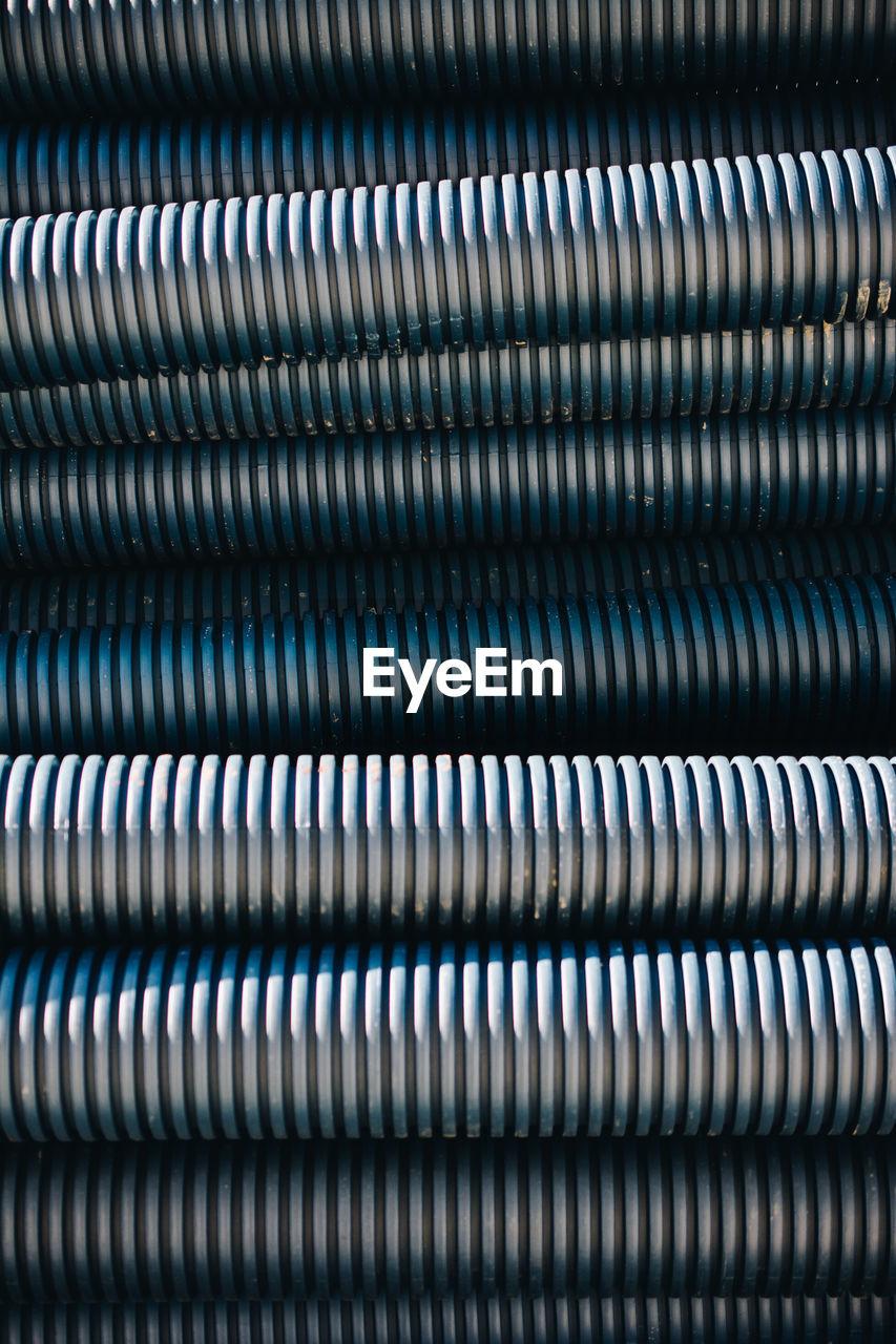 Full frame shot of metal pipes