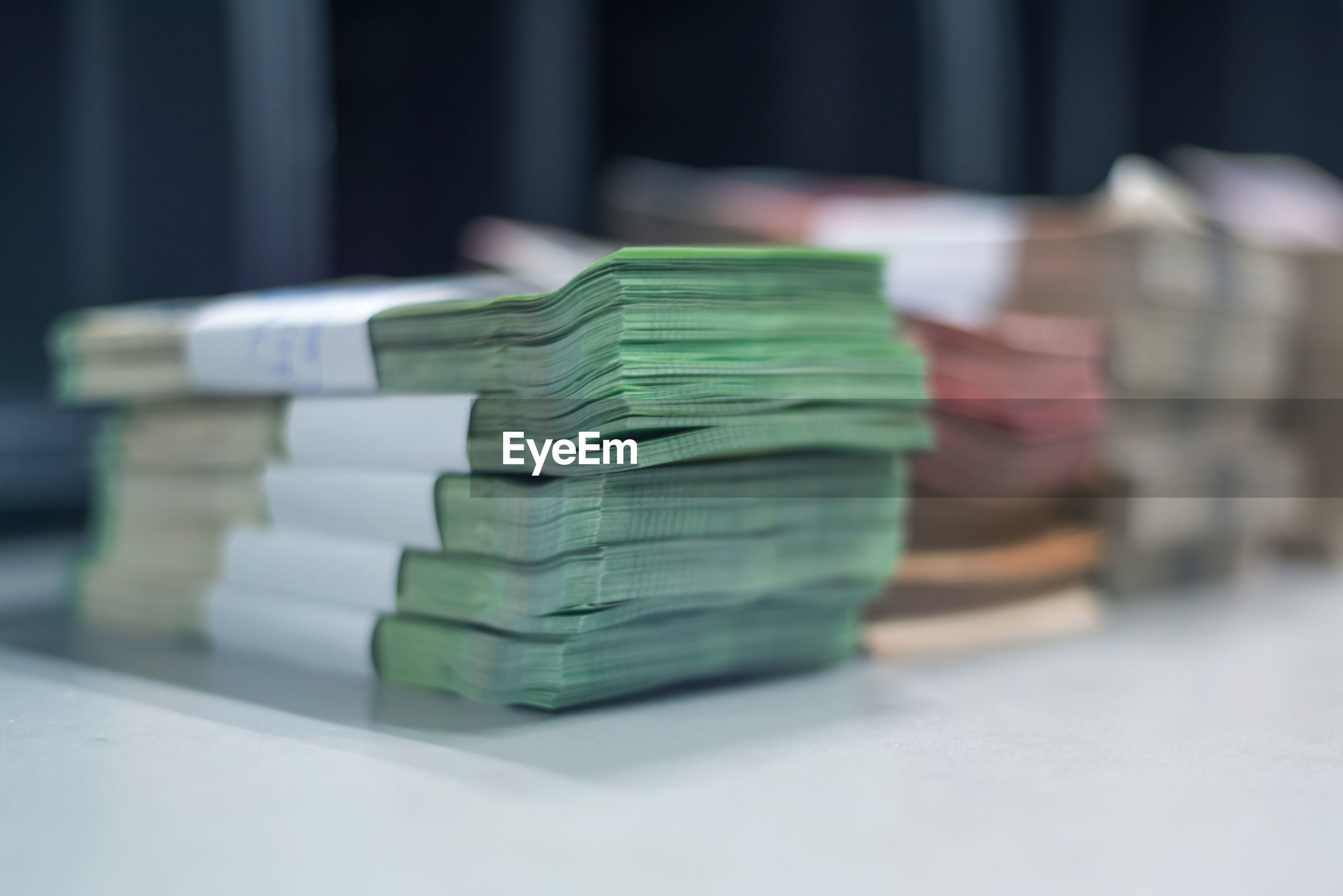 Close-up of banknotes bundle on table