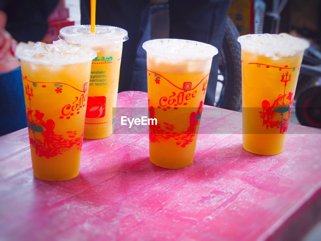 food and drink, drink, refreshment, drinking straw, table, freshness, indoors, cold temperature, drinking glass, yellow, multi colored, close-up, no people, day