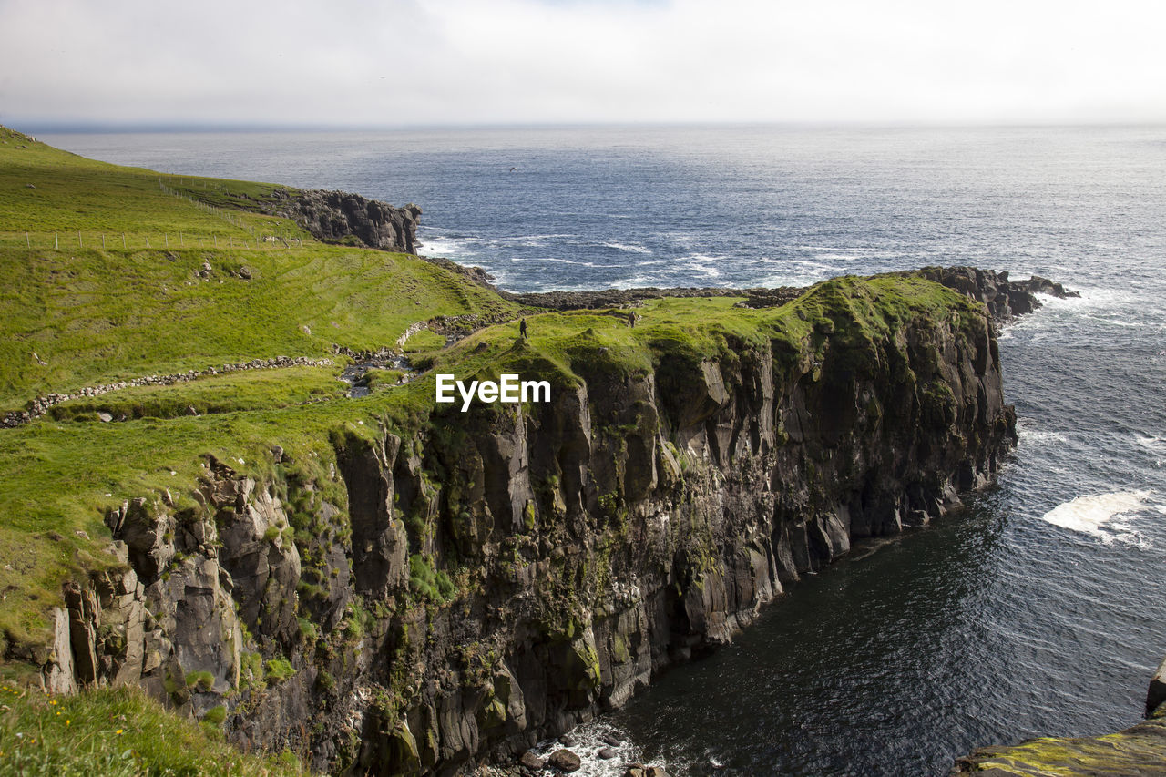 sea, scenics - nature, water, beauty in nature, tranquil scene, sky, tranquility, land, horizon over water, no people, horizon, non-urban scene, idyllic, nature, day, plant, cliff, green color, rock, outdoors, rocky coastline