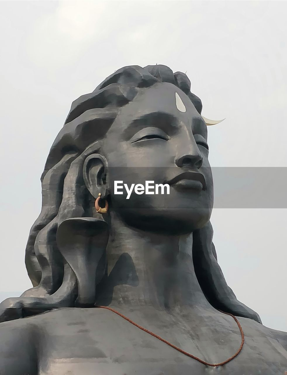 sculpture, statue, human representation, representation, art and craft, male likeness, low angle view, no people, creativity, sky, religion, day, spirituality, belief, close-up, nature, craft, outdoors, idol