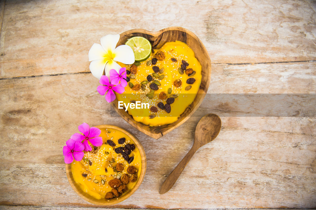 flower, freshness, petal, indoors, food and drink, flower head, high angle view, studio shot, yellow, no people, wood - material, fragility, healthy eating, close-up, food, day