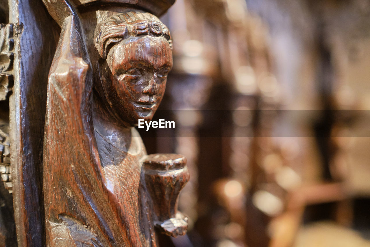 sculpture, human representation, art and craft, representation, statue, creativity, male likeness, focus on foreground, no people, close-up, craft, day, carving - craft product, history, outdoors, weathered, architecture, the past, spirituality, religion, idol