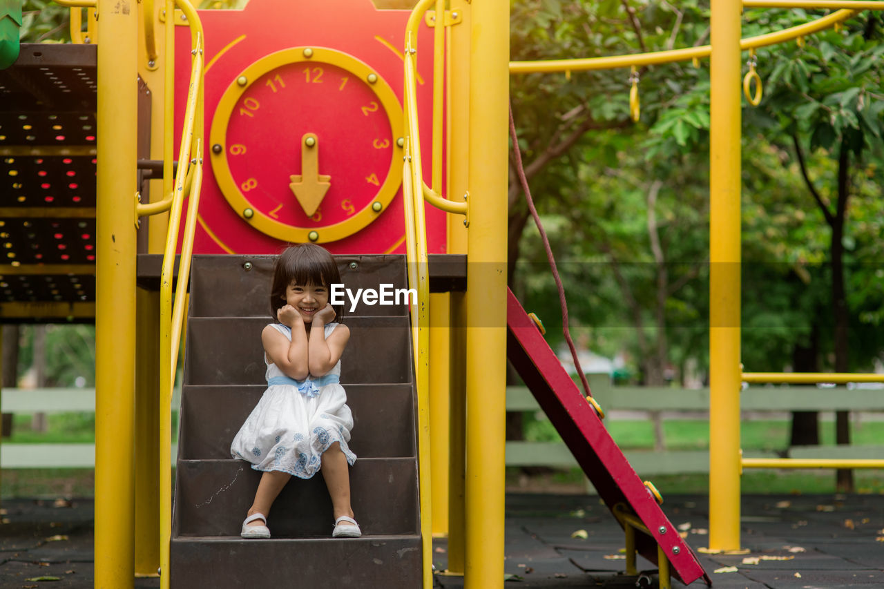 childhood, child, full length, girls, real people, one person, leisure activity, females, day, playground, innocence, women, front view, yellow, casual clothing, lifestyles, outdoor play equipment, boys, outdoors, jungle gym