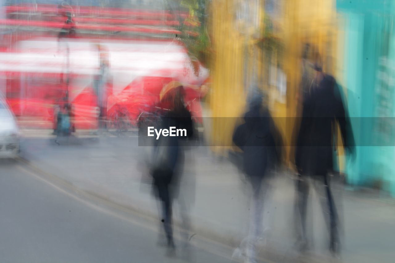 blurred motion, motion, speed, walking, men, real people, day, outdoors, city, architecture, people