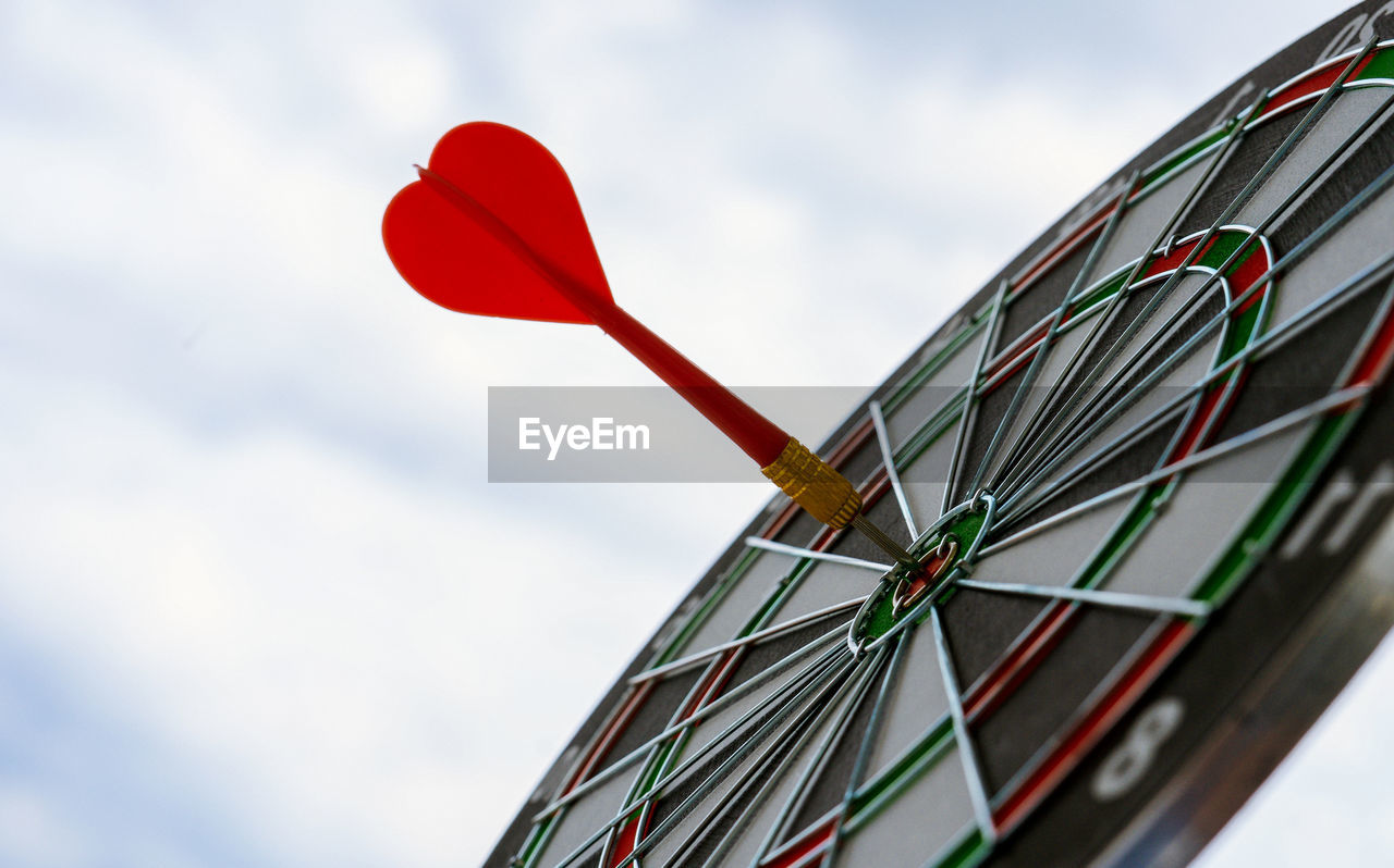 Low Angle View Of Dartboard Against Sky