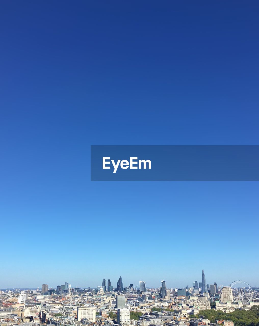 VIEW OF CITYSCAPE AGAINST BLUE SKY