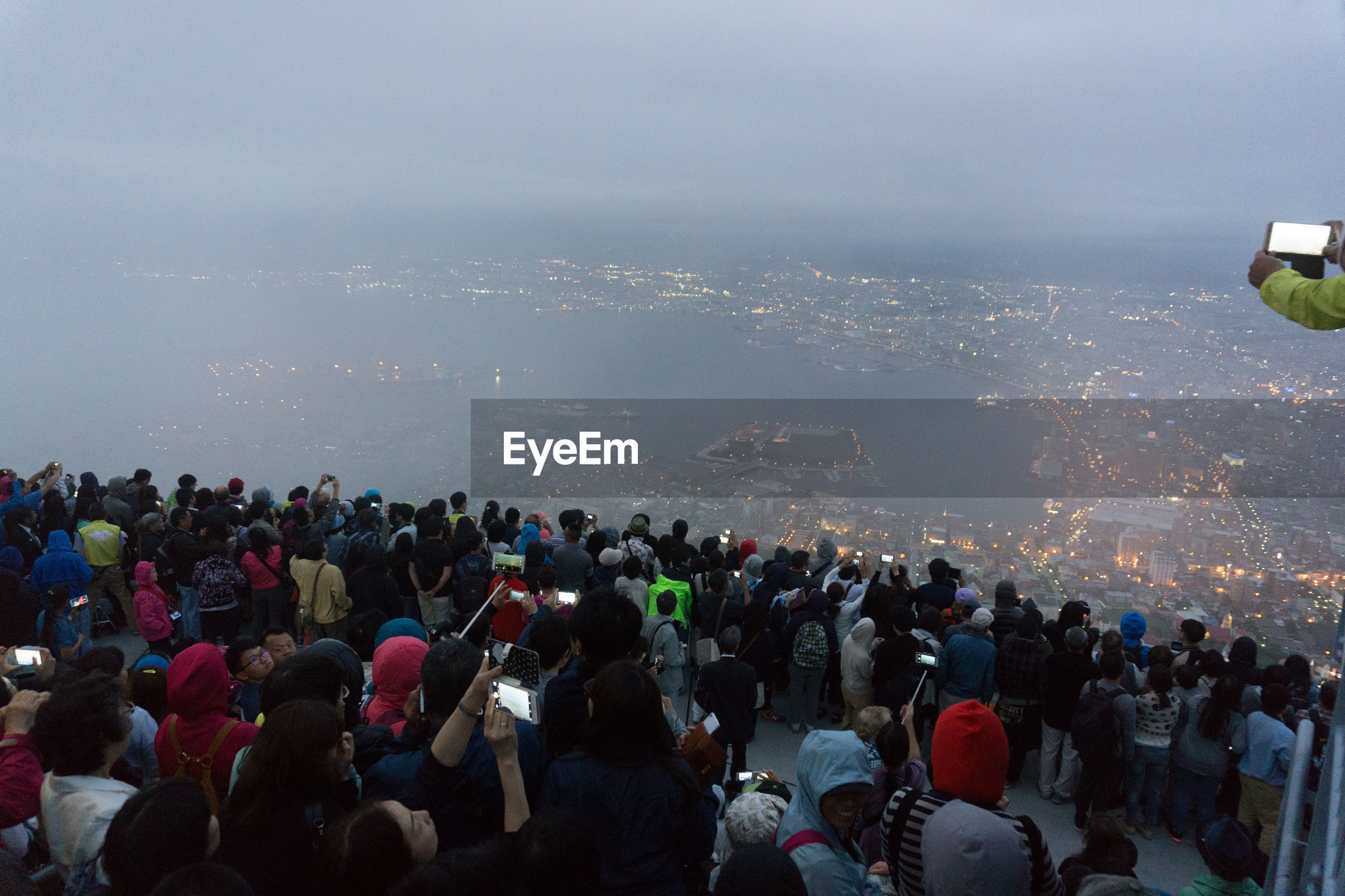 High angle view of people standing at mount hakodate in city against sky