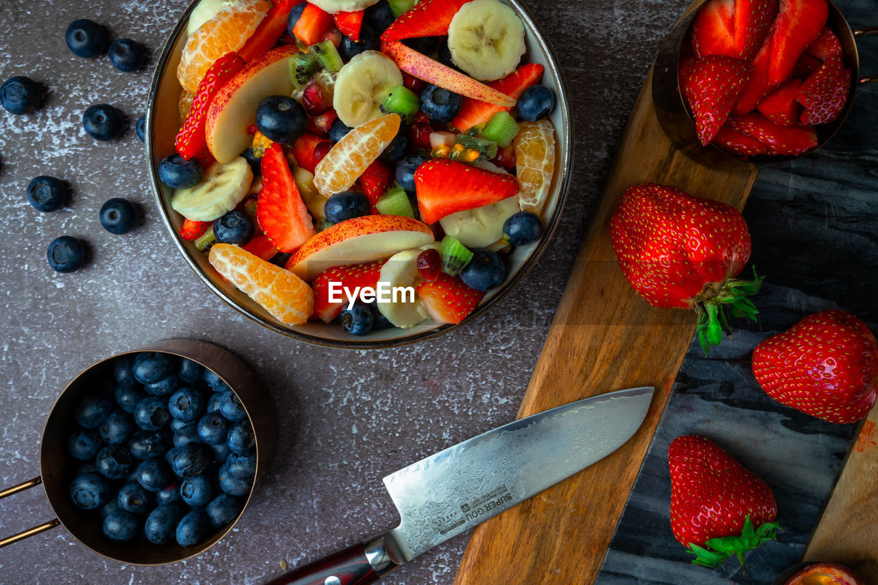 High angle view of chopped fresh fruits in bowl