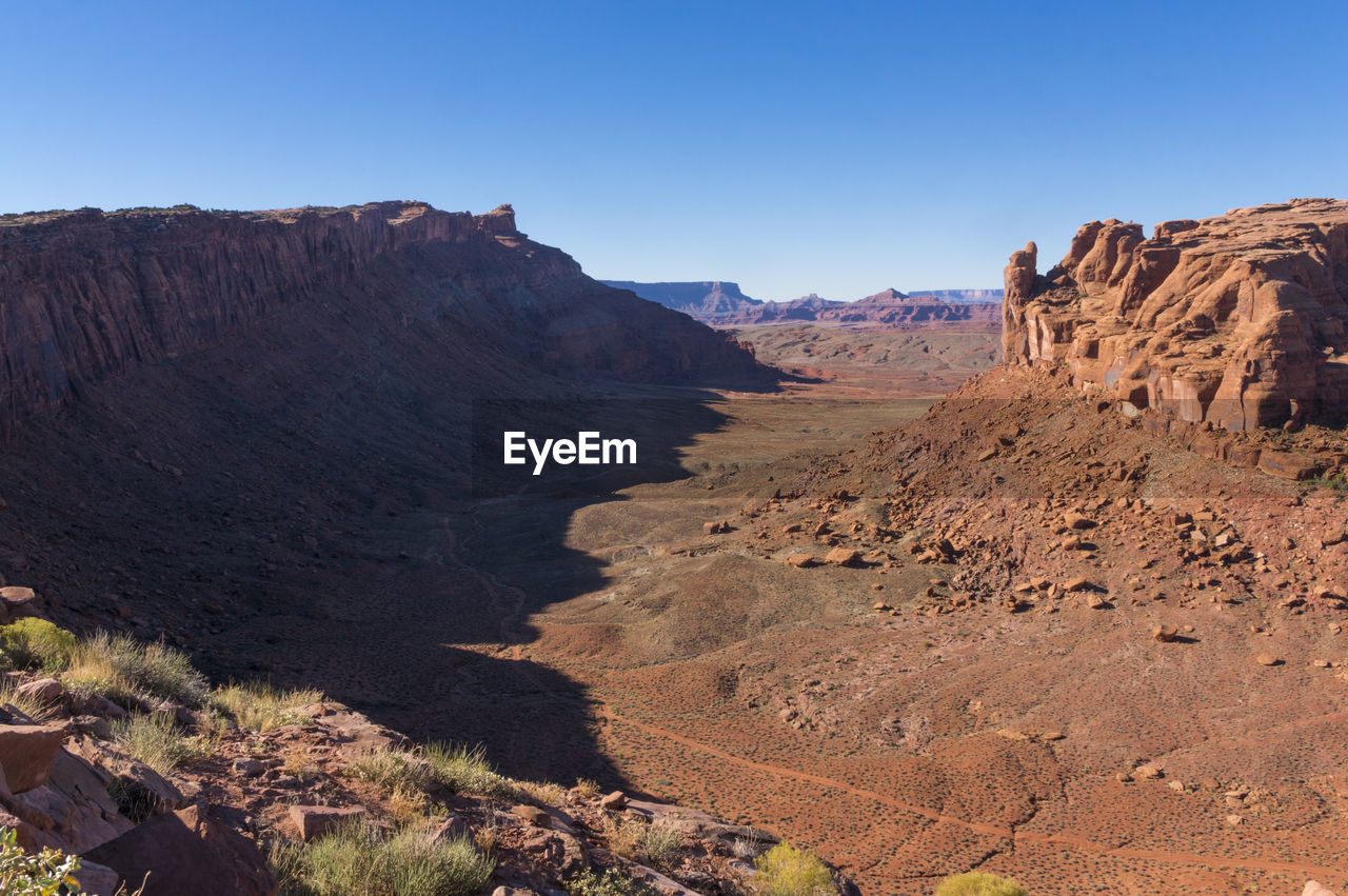 Scenic View Of Red Rock Against Clear Blue Sky