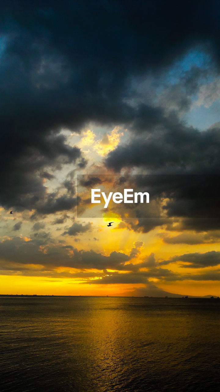 sky, sunset, cloud - sky, scenics - nature, beauty in nature, water, tranquil scene, tranquility, sea, horizon, horizon over water, waterfront, orange color, no people, yellow, idyllic, nature, mid-air, flying, outdoors