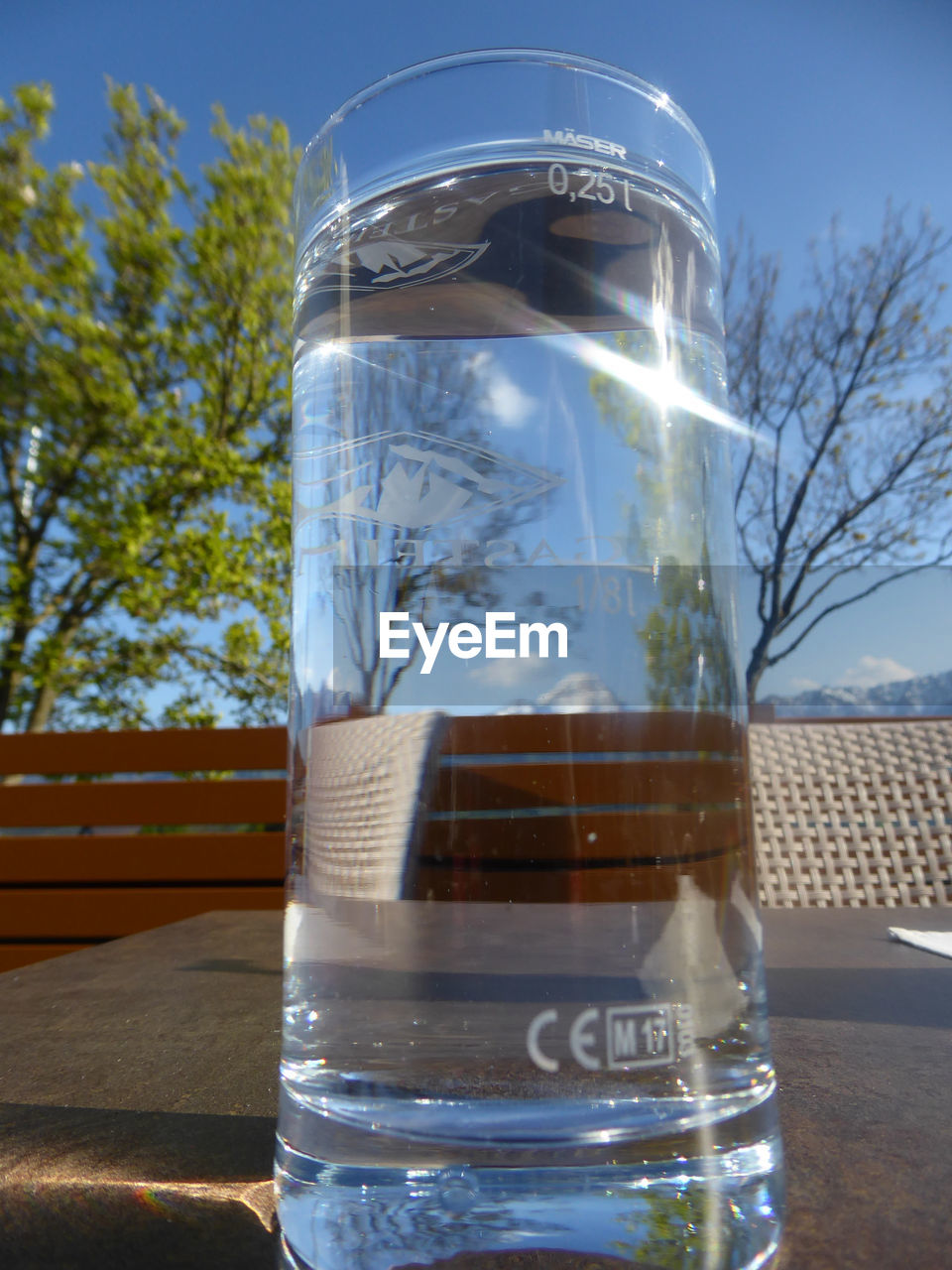 drink, transparent, glass - material, refreshment, table, nature, food and drink, no people, glass, close-up, drinking water, container, plant, focus on foreground, freshness, water, drinking glass, tree, household equipment, outdoors