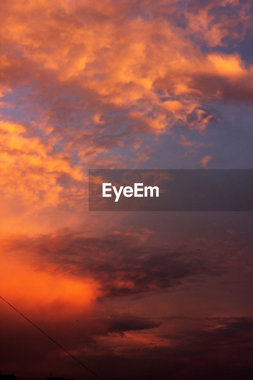 sky, cloud - sky, sunset, orange color, beauty in nature, scenics - nature, tranquility, no people, tranquil scene, low angle view, nature, idyllic, dramatic sky, outdoors, cloudscape, cable, sunlight, electricity, awe, meteorology, power supply, romantic sky