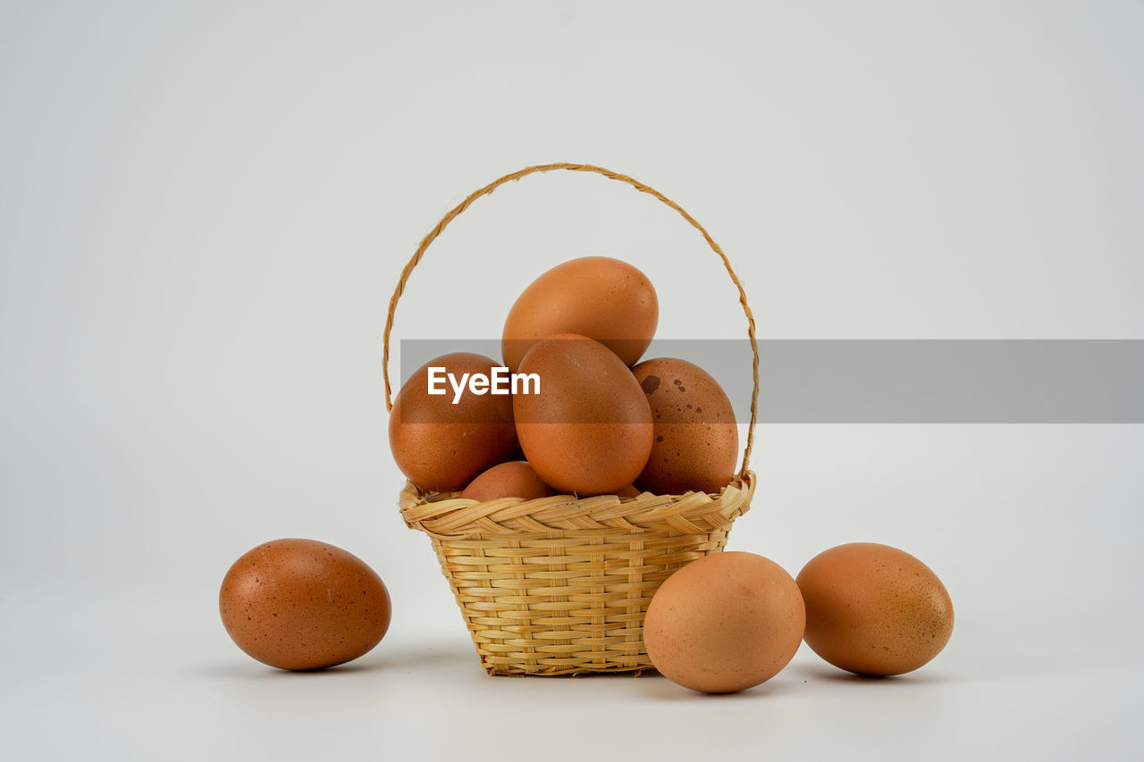 wellbeing, food, healthy eating, food and drink, studio shot, freshness, white background, egg, indoors, still life, close-up, raw food, brown, no people, copy space, container, group of objects, medium group of objects, basket, cut out