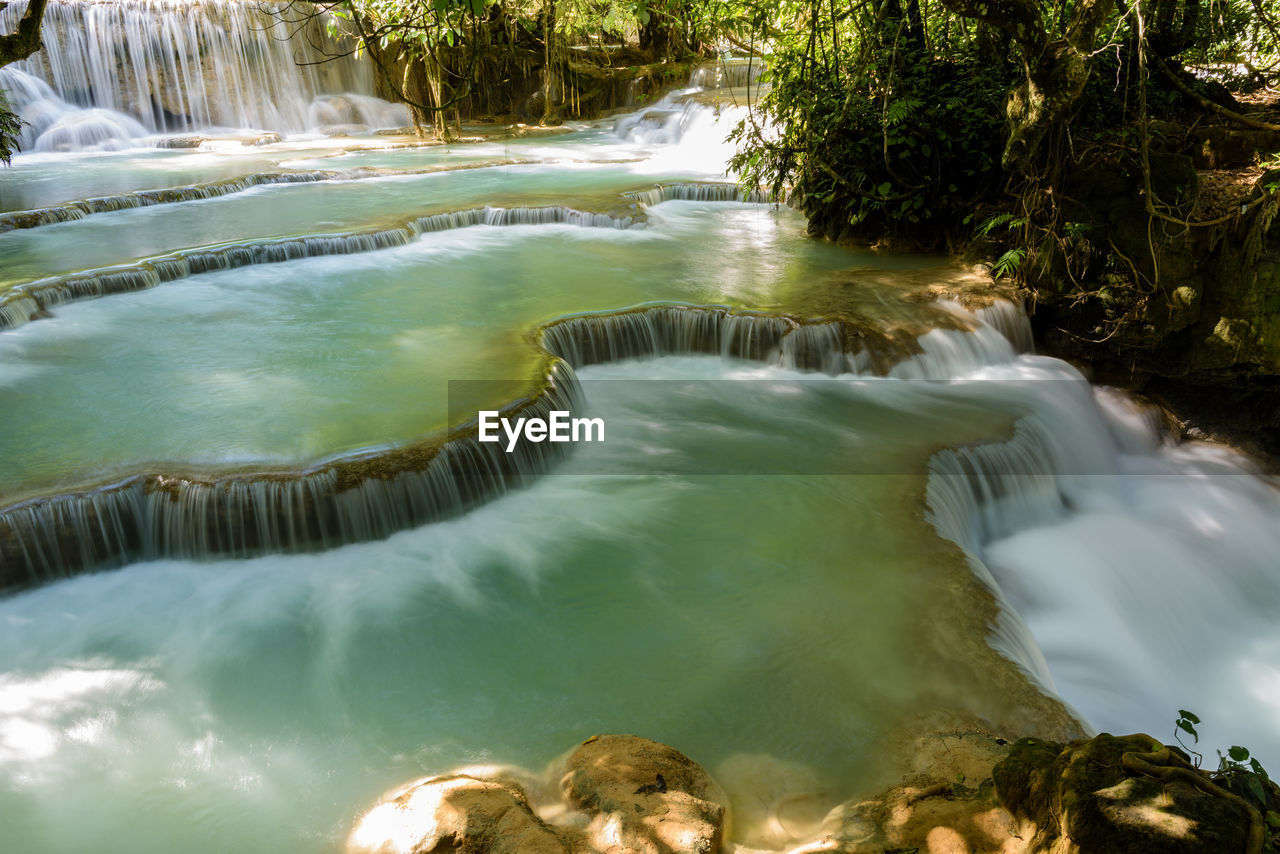 water, motion, flowing water, waterfall, long exposure, nature, beauty in nature, outdoors, no people, day, scenics, hot spring, tree