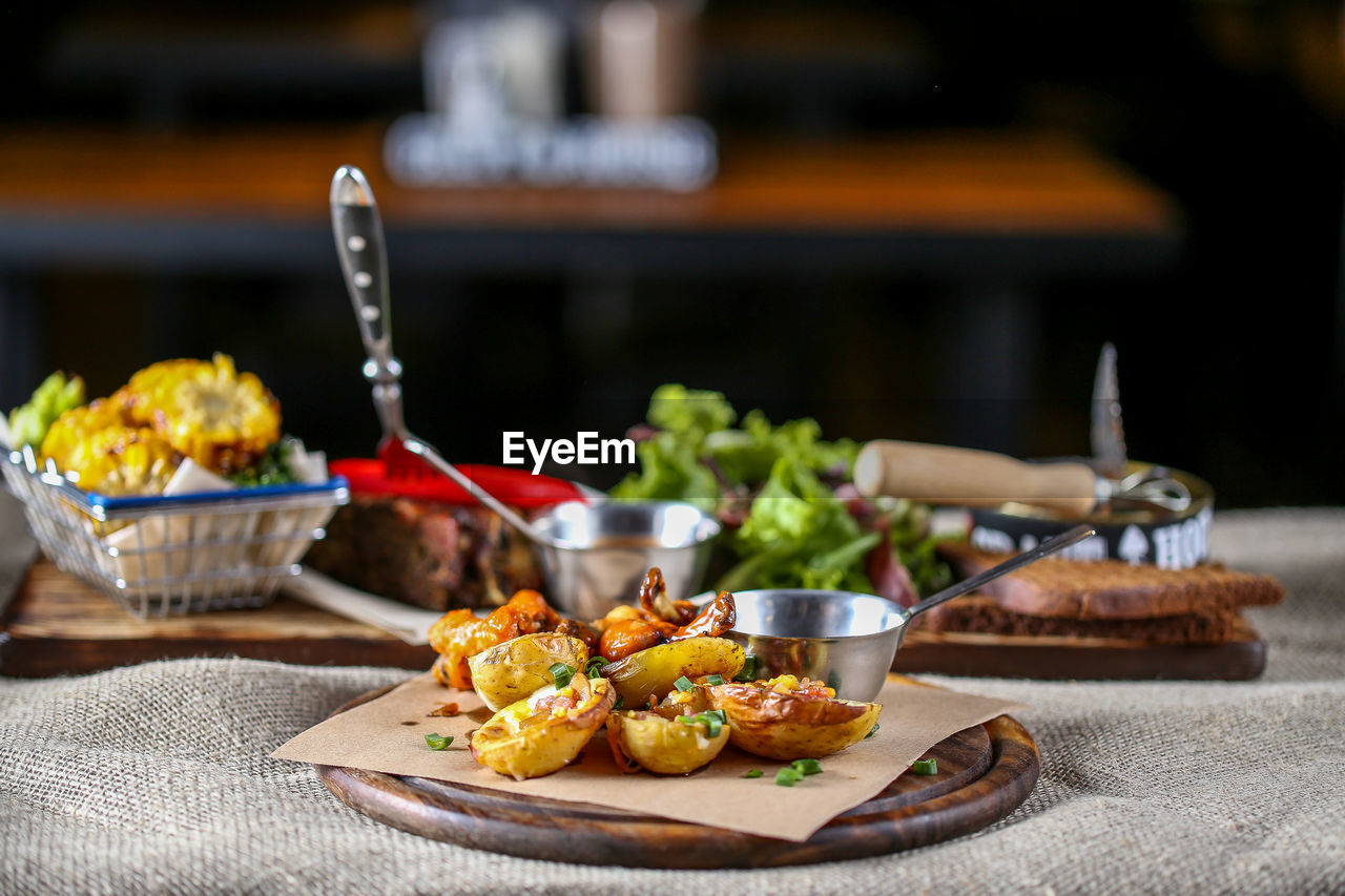 food and drink, food, freshness, healthy eating, focus on foreground, table, ready-to-eat, no people, still life, vegetable, close-up, plate, serving size, indoors, wellbeing, meat, kitchen utensil, bowl, selective focus, business, tray, snack