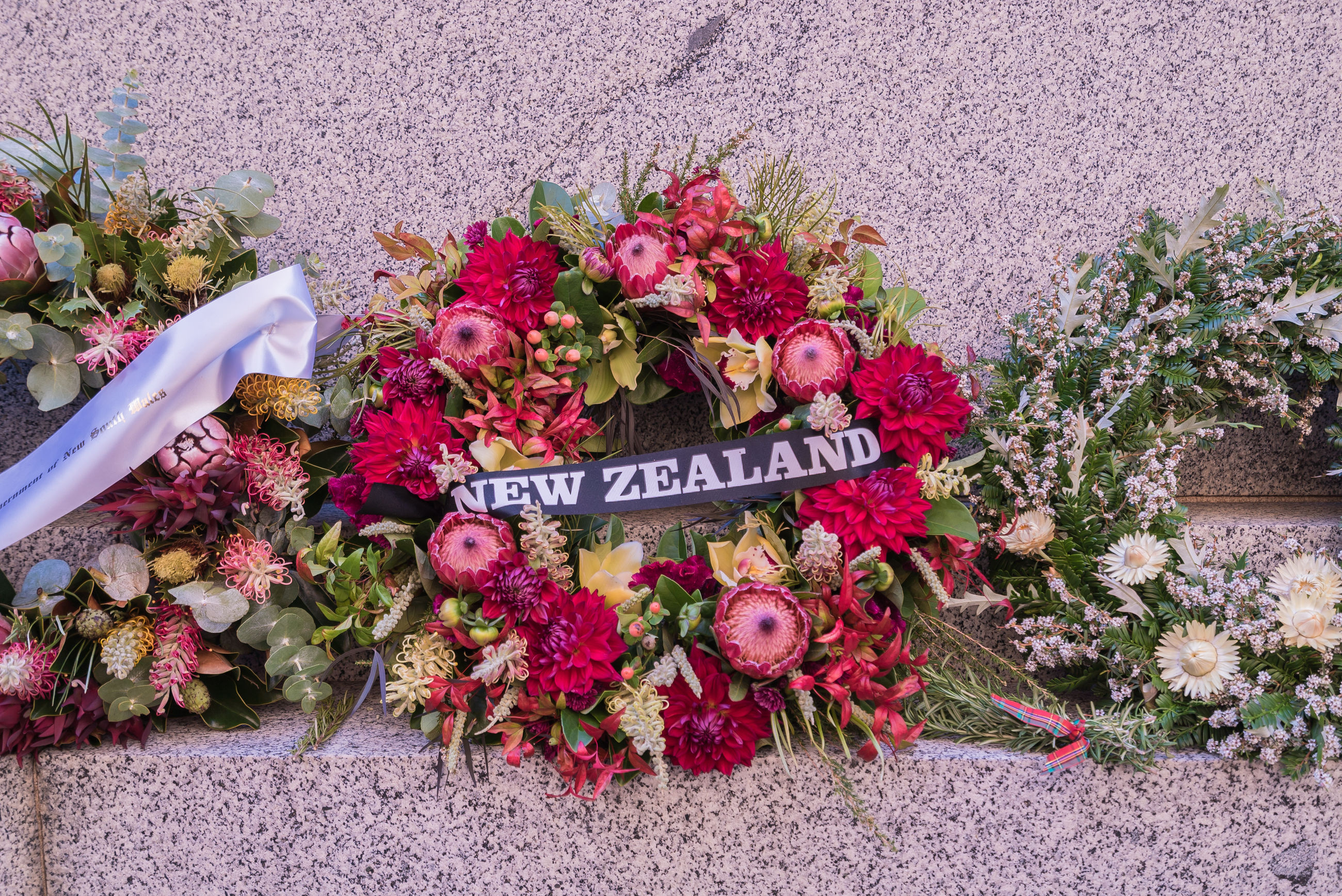 Close-up of wreaths with text