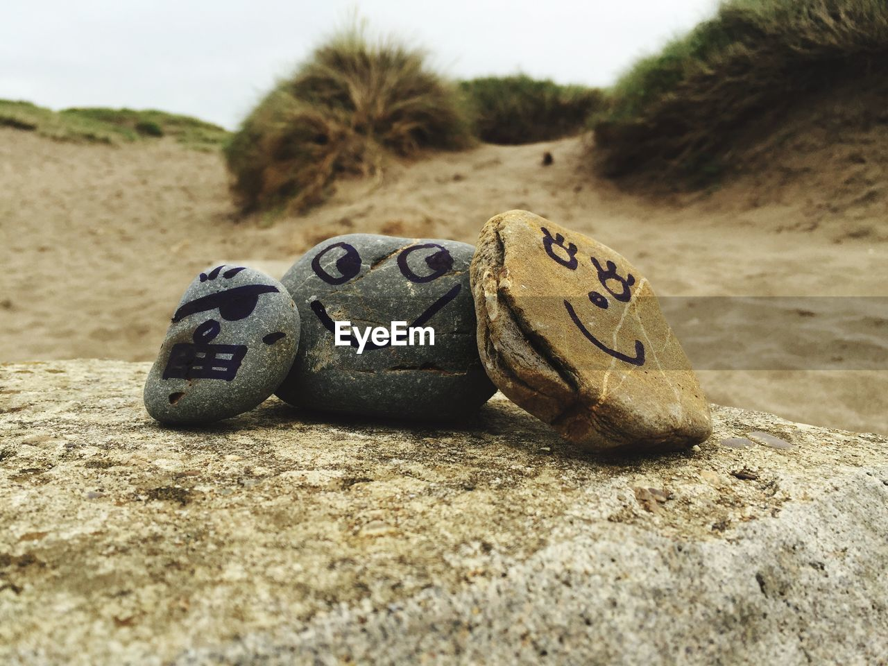 CLOSE-UP OF SHOES ON SAND