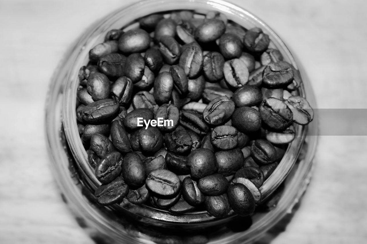 food and drink, food, freshness, container, still life, indoors, close-up, large group of objects, coffee - drink, coffee, abundance, table, no people, healthy eating, selective focus, bowl, high angle view, roasted coffee bean, drink, glass - material, temptation, caffeine