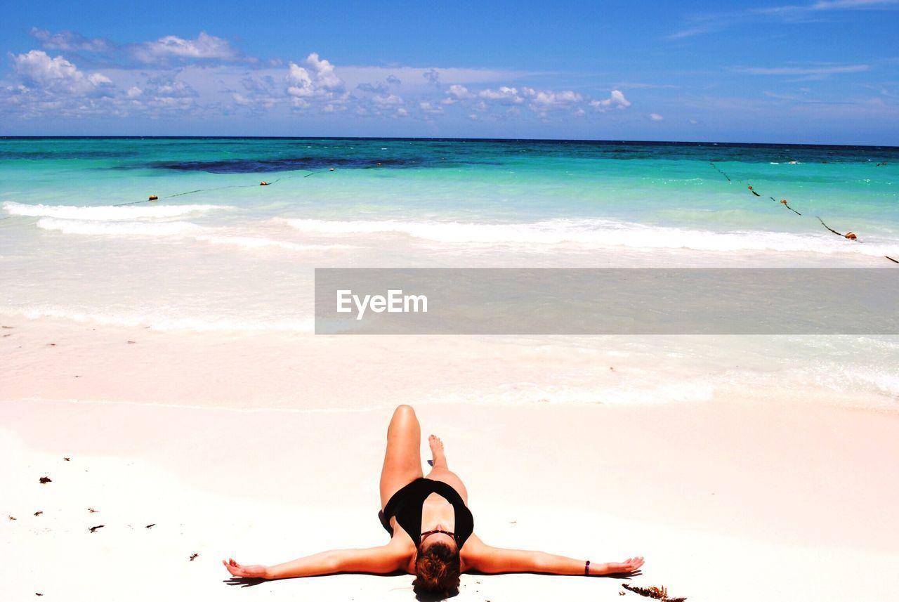 Woman At Beach Against Sky