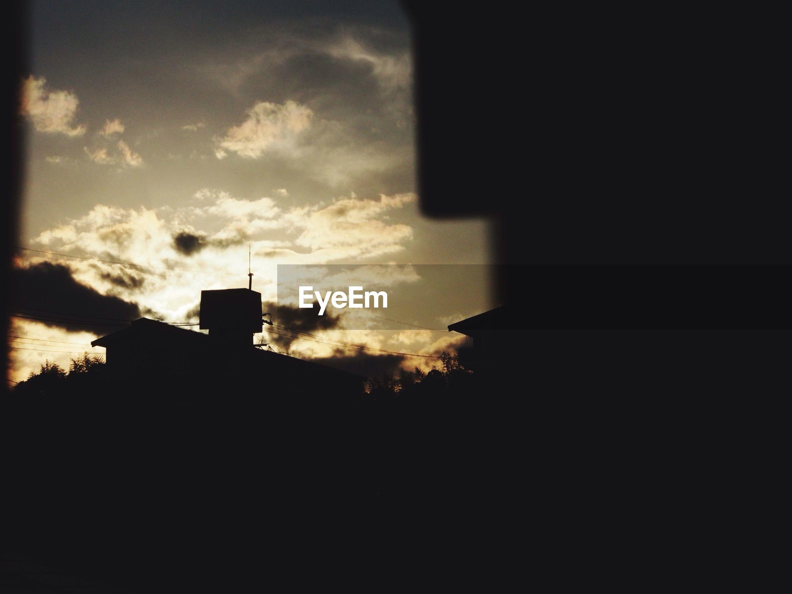 silhouette, architecture, built structure, building exterior, sunset, sky, low angle view, cloud - sky, dark, house, dusk, outline, cloud, building, outdoors, orange color, no people, nature, religion, church