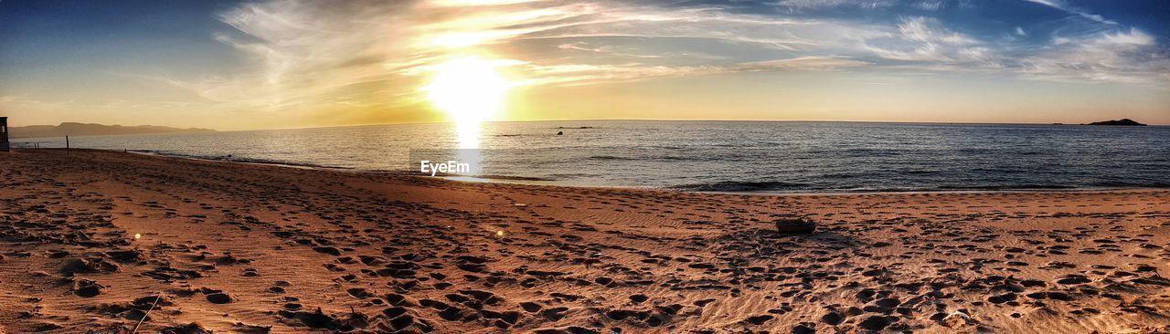 sky, land, sea, beauty in nature, beach, water, sunset, scenics - nature, sand, tranquil scene, cloud - sky, horizon over water, tranquility, horizon, nature, idyllic, sunlight, no people, non-urban scene, sun, outdoors