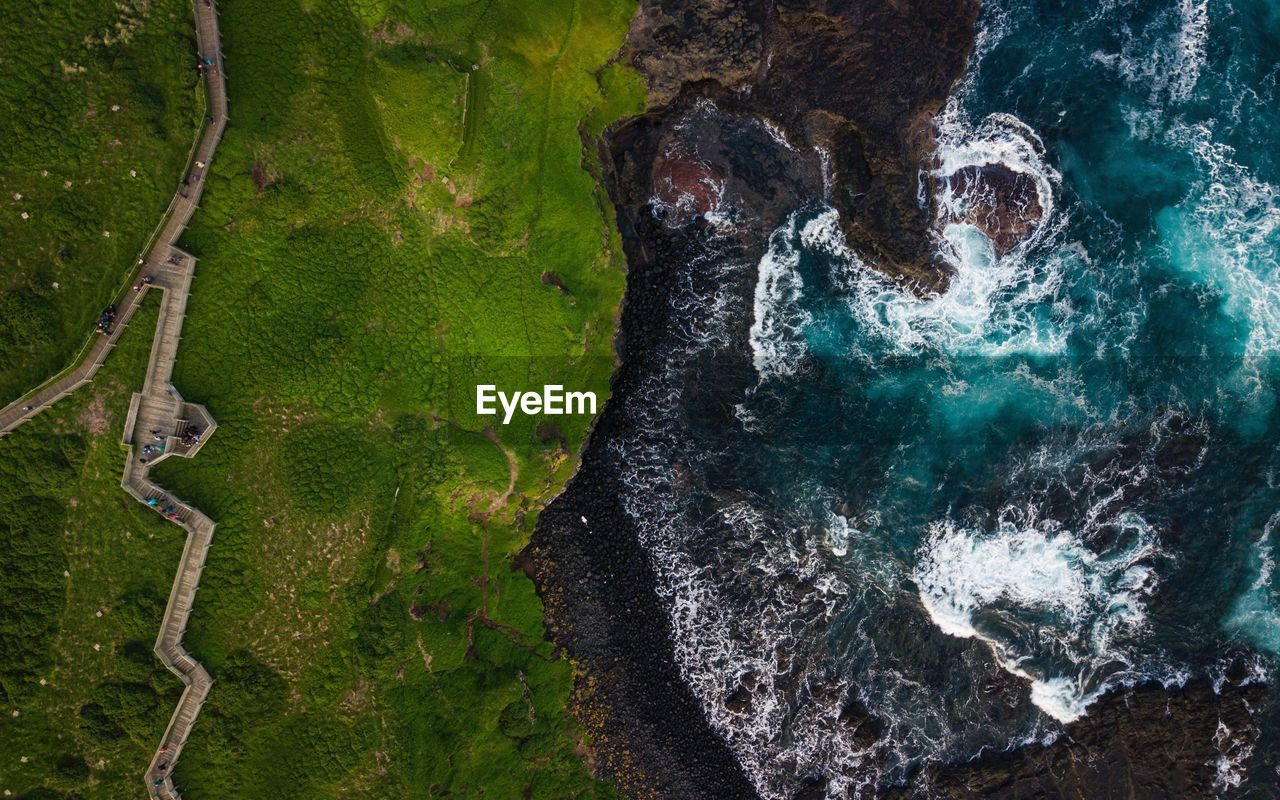 water, nature, no people, beauty in nature, green color, day, high angle view, aerial view, outdoors, scenics - nature, sea, non-urban scene, tranquility, environment, tranquil scene, rock, land, geology, power in nature, flowing
