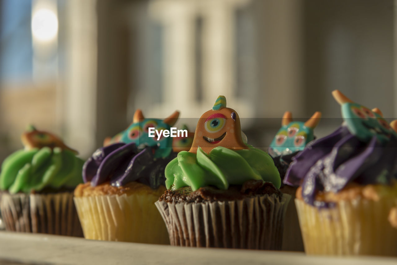 sweet food, cake, representation, animal representation, dessert, baked, sweet, food and drink, food, celebration, still life, no people, close-up, indoors, selective focus, indulgence, focus on foreground, unhealthy eating, temptation, cupcake