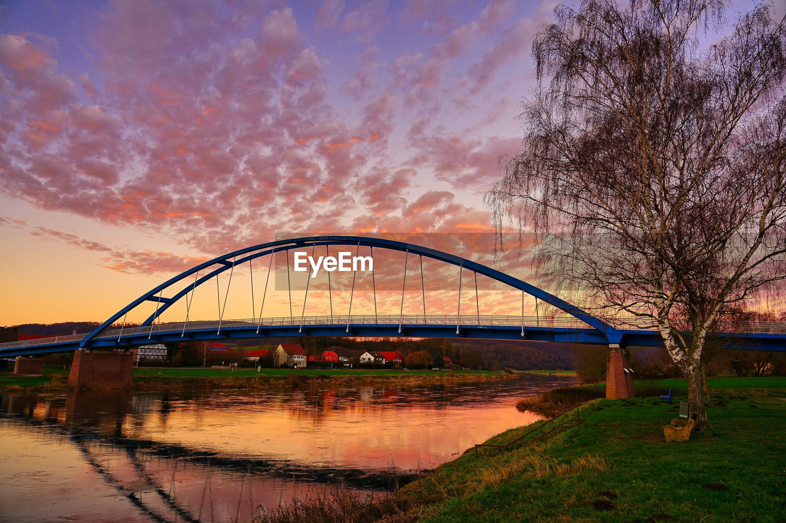 VIEW OF BRIDGE OVER RIVER AGAINST SKY DURING SUNSET