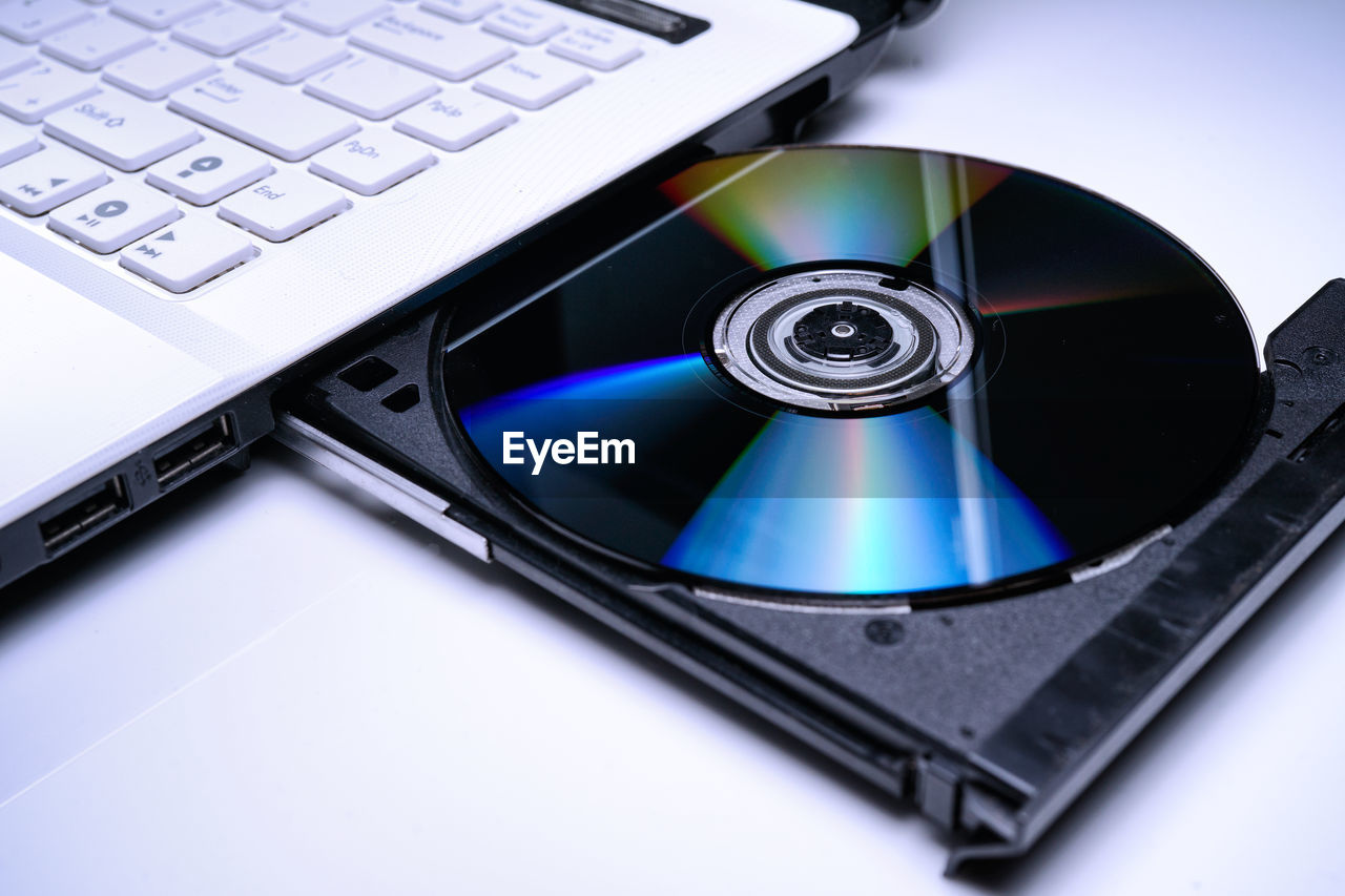 computer, computer equipment, technology, wireless technology, keyboard, laptop, computer keyboard, communication, connection, close-up, portable information device, no people, indoors, still life, compact disc, data, blue, equipment, computer part, desktop pc, silver colored, electrical equipment, computer key