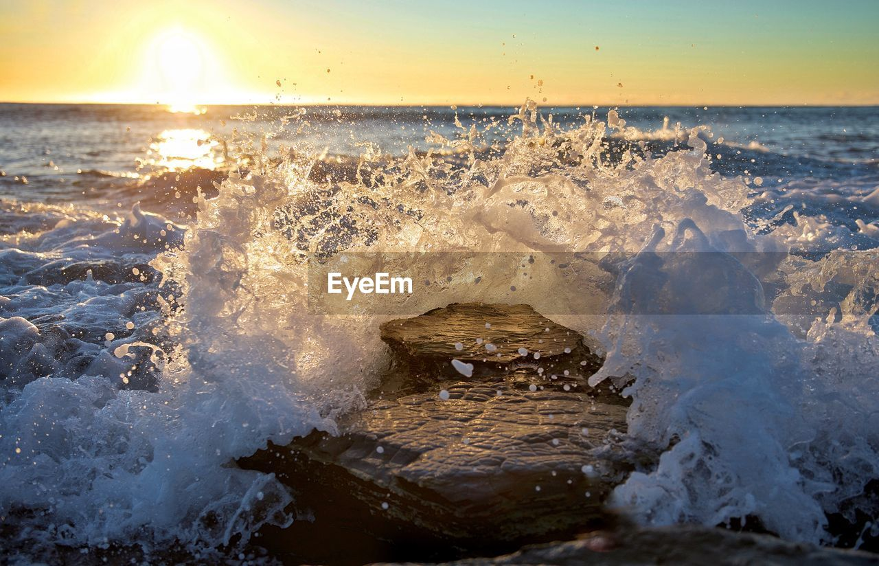 water, sea, motion, wave, sunset, sky, beauty in nature, nature, splashing, sport, power in nature, horizon over water, aquatic sport, scenics - nature, beach, no people, power, land, outdoors, breaking, hitting, flowing water