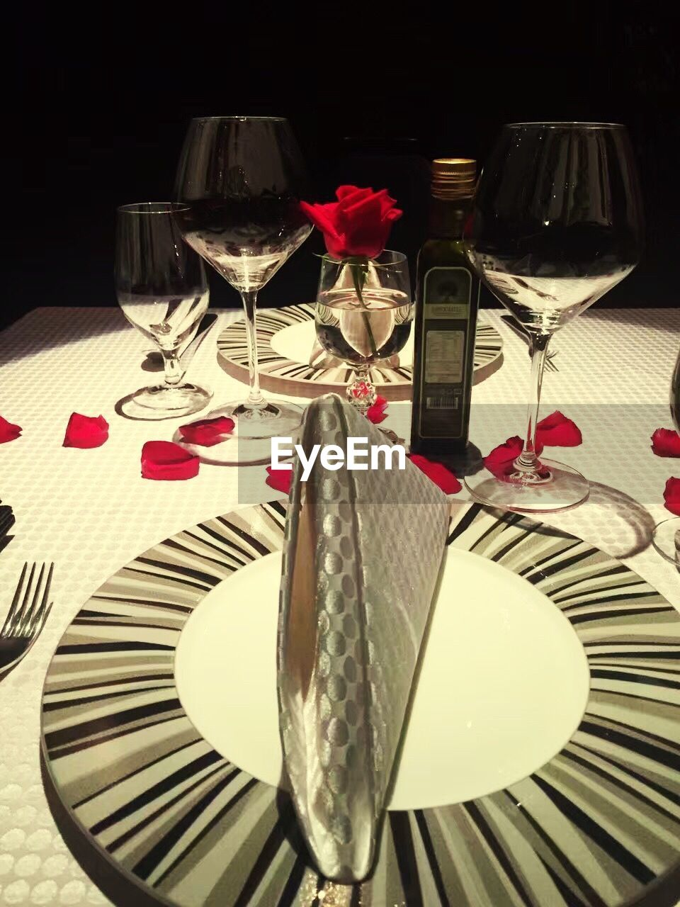 wineglass, table, fork, wine, food and drink, red wine, red, still life, plate, table knife, drinking glass, place setting, food, indoors, drink, alcohol, no people, wine bottle, tablecloth, close-up, night, flower, ready-to-eat, freshness