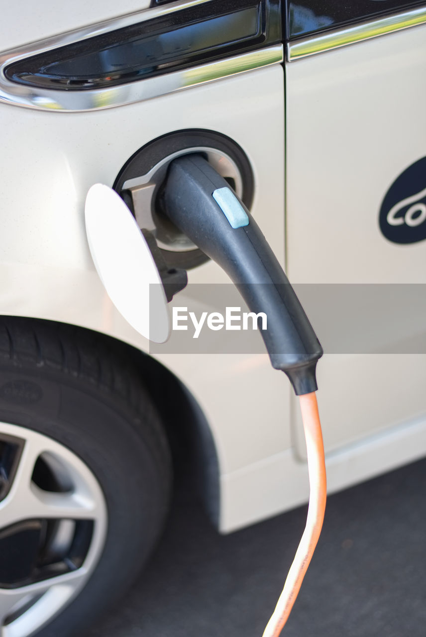 High angle view of electric car being charged