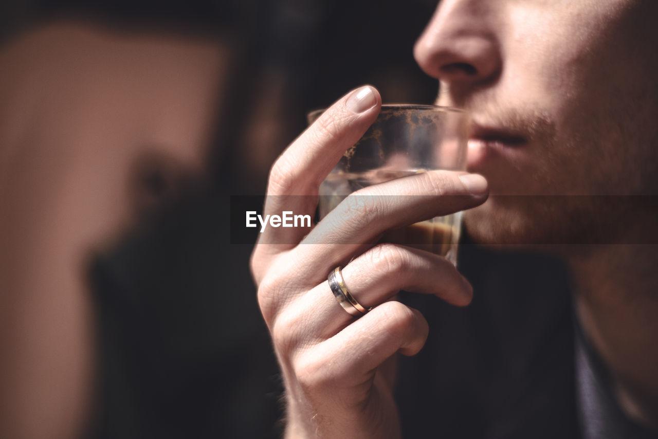 Close-Up Of Men Drinking Tea