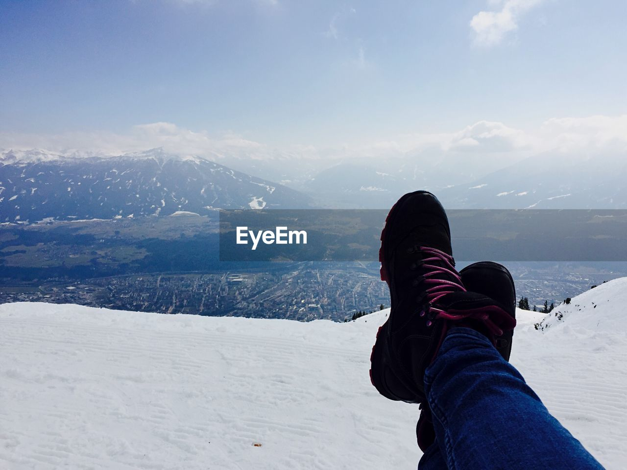 Low Section Of Person Relaxing On Snowcapped Mountain