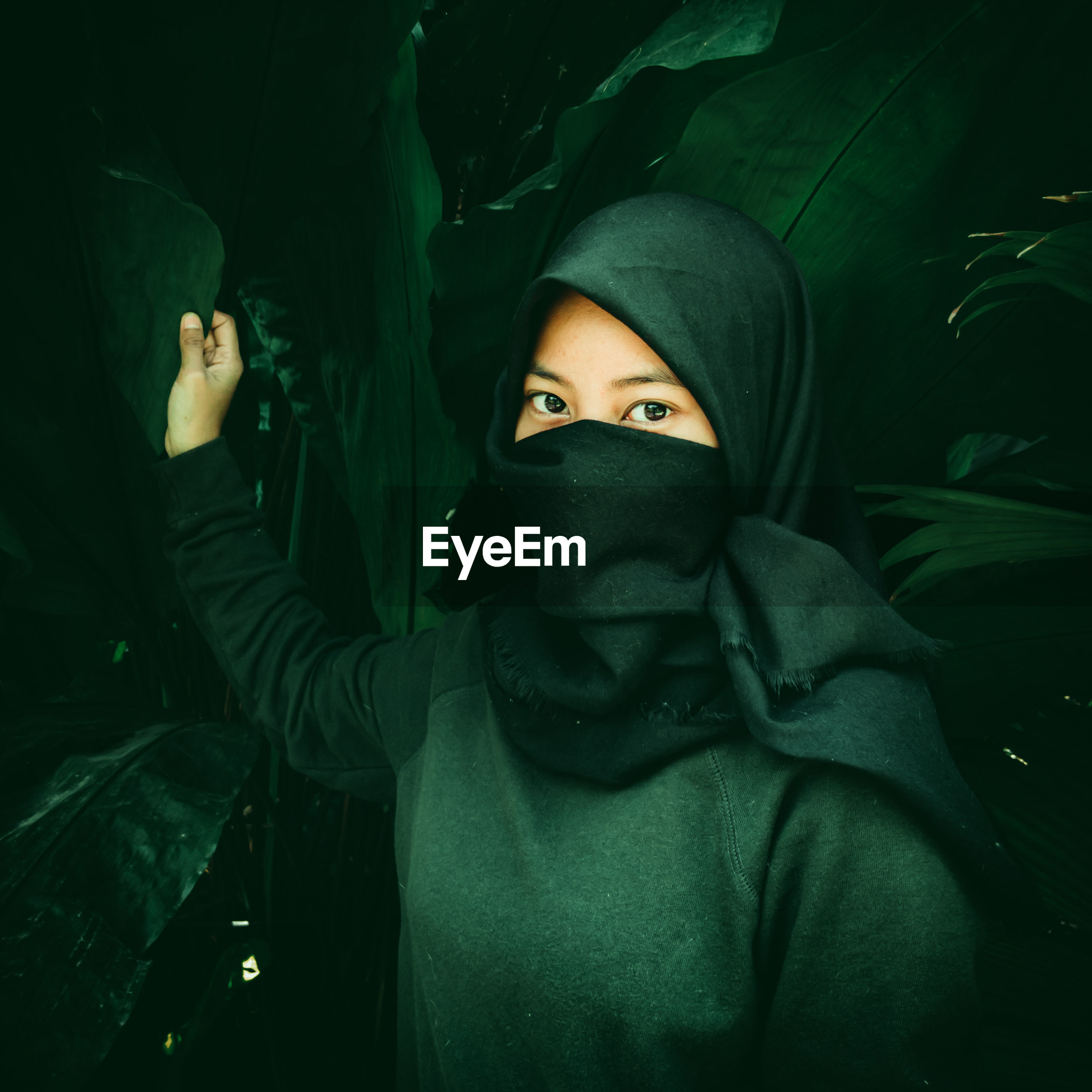 Veiled woman with a dark green effect