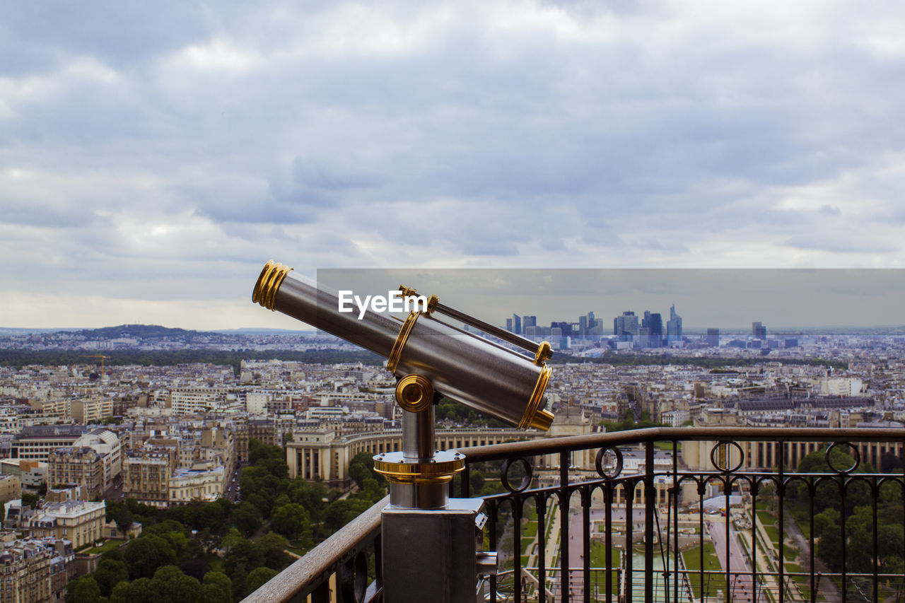cityscape, coin operated, coin-operated binoculars, hand-held telescope, city, telescope, architecture, sky, building exterior, built structure, cloud - sky, crowded, travel destinations, outdoors, day
