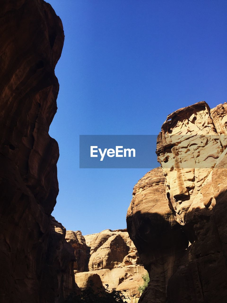 rock, rock formation, rock - object, solid, sky, clear sky, geology, low angle view, nature, blue, physical geography, day, scenics - nature, copy space, no people, beauty in nature, tranquility, travel destinations, tranquil scene, travel, eroded, outdoors, formation, climate, arid climate