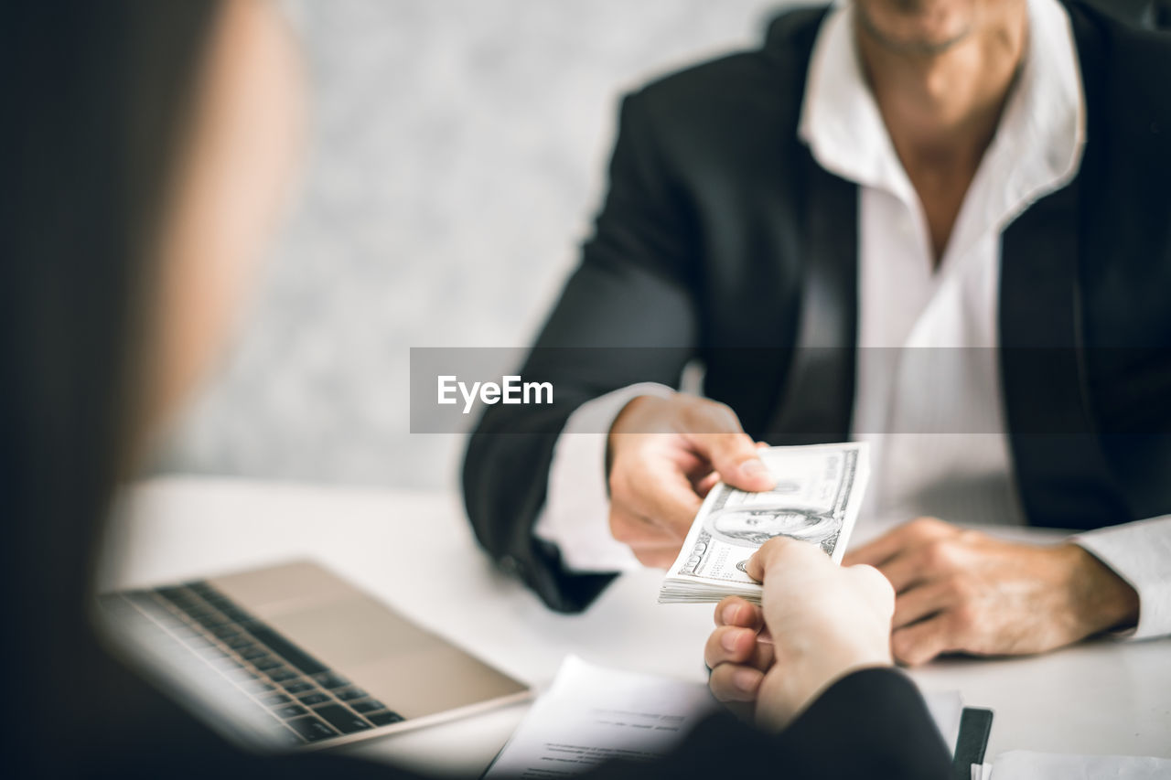 business, business person, men, holding, selective focus, adult, communication, finance, males, wireless technology, technology, midsection, table, businessman, human hand, professional occupation, occupation, corporate business, people, mature adult, hand, mature men