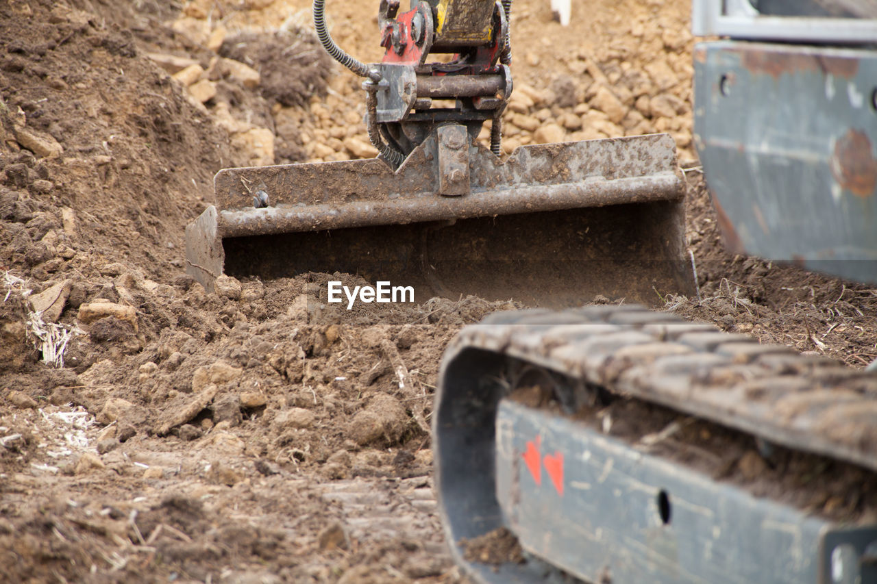 Close-up of earth mover working at construction site