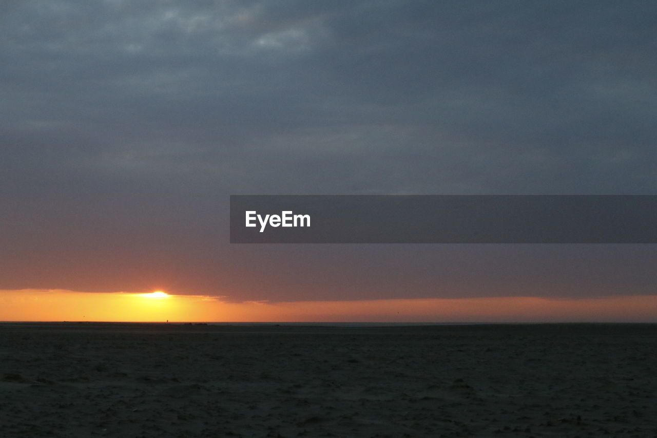 sky, sea, water, sunset, horizon, sun, horizon over water, nature, beach, land, freedom, beauty in nature, tranquility, remote, no people, cloud - sky, scenics - nature, outdoors, positive emotion