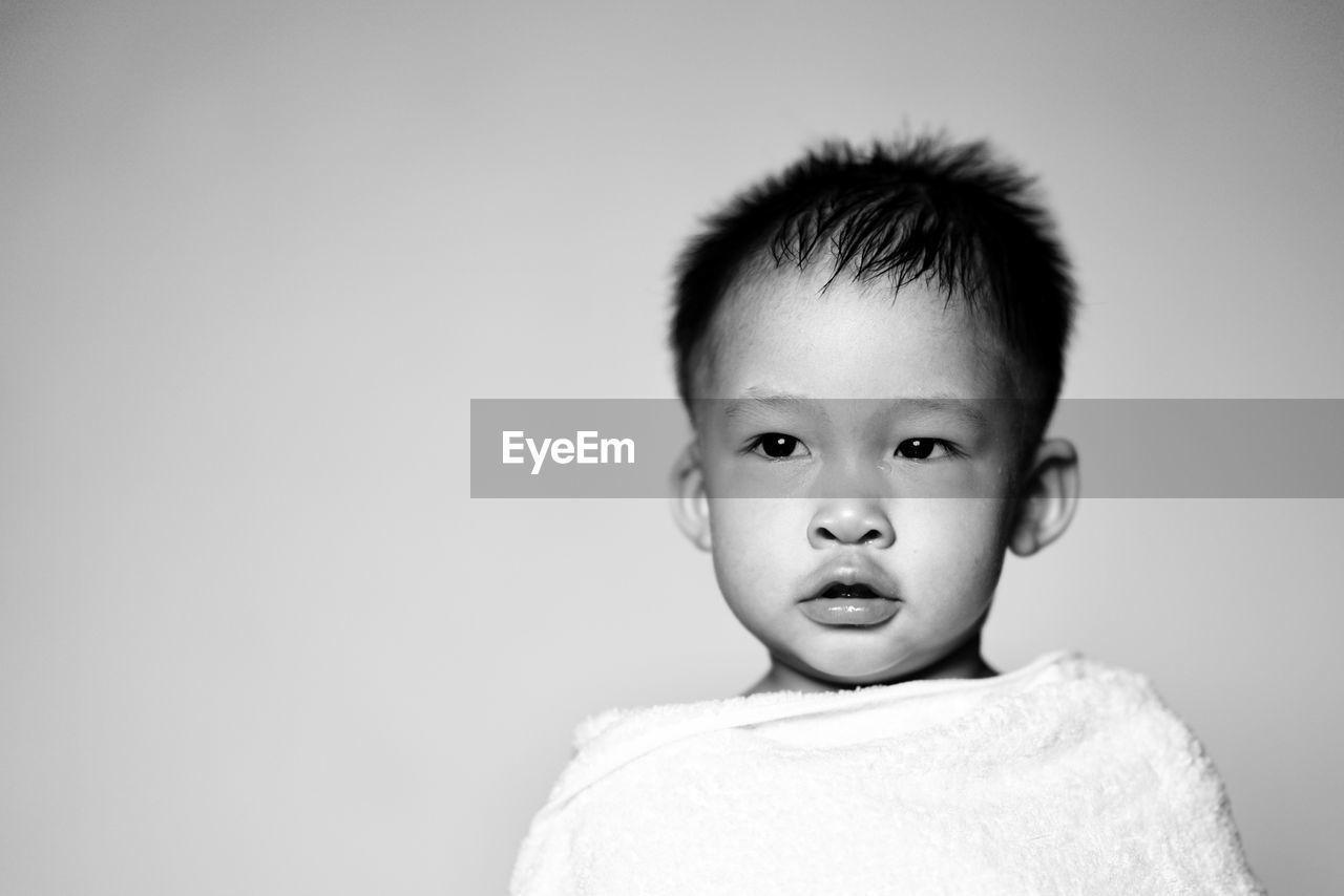 Cute Boy Against Gray Background