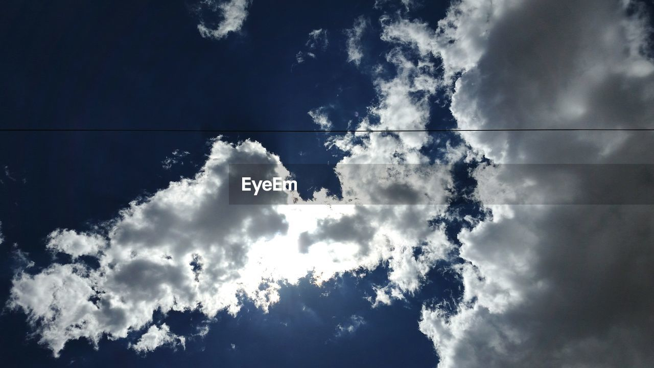 cloud - sky, sky, low angle view, cable, beauty in nature, nature, day, outdoors, no people, blue, scenics, technology