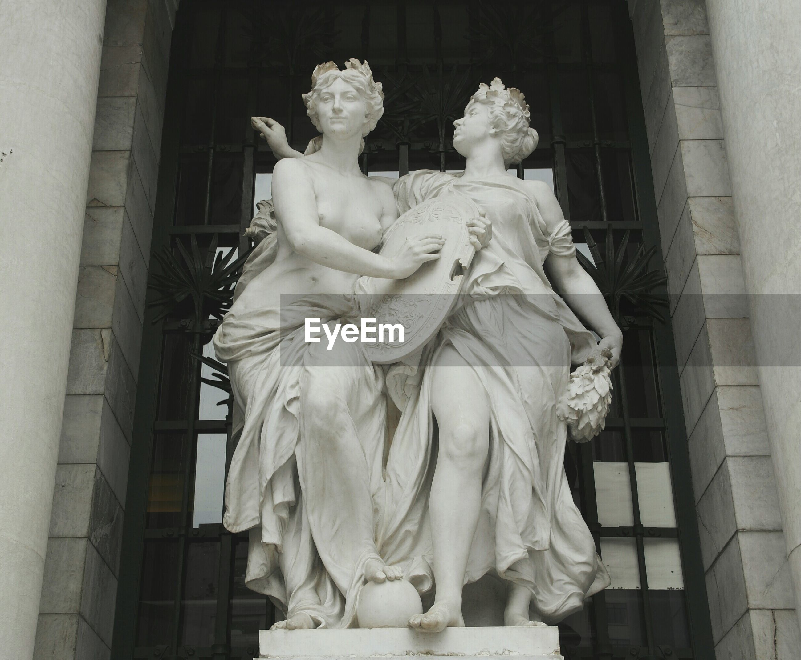 statue, human representation, sculpture, art and craft, art, creativity, low angle view, architecture, built structure, carving - craft product, famous place, religion, travel destinations, building exterior, spirituality, history, animal representation, tourism