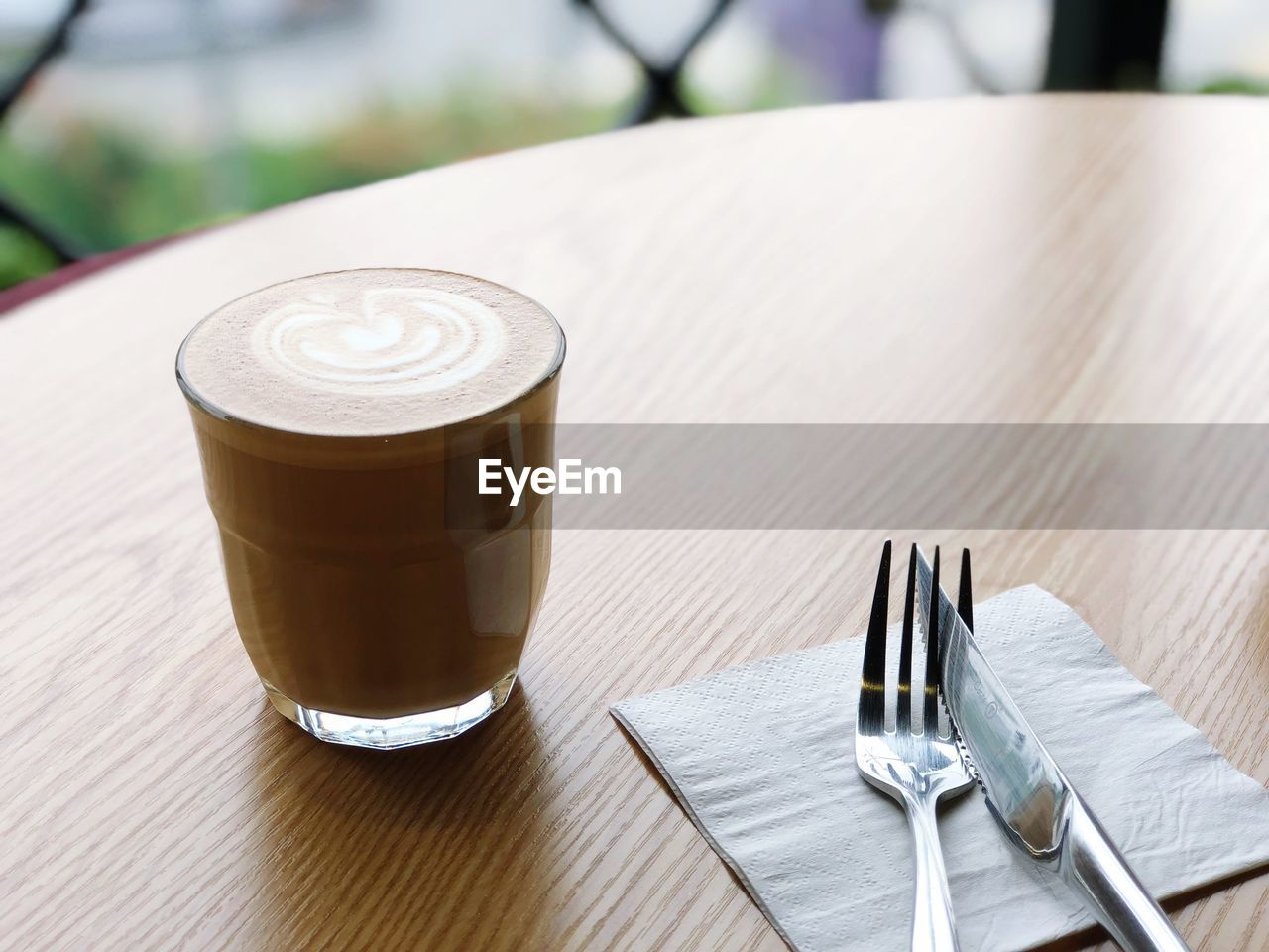 table, eating utensil, drink, food and drink, refreshment, fork, still life, focus on foreground, kitchen utensil, coffee, coffee - drink, household equipment, frothy drink, close-up, no people, wood - material, coffee cup, glass, cup, freshness, table knife, latte, crockery