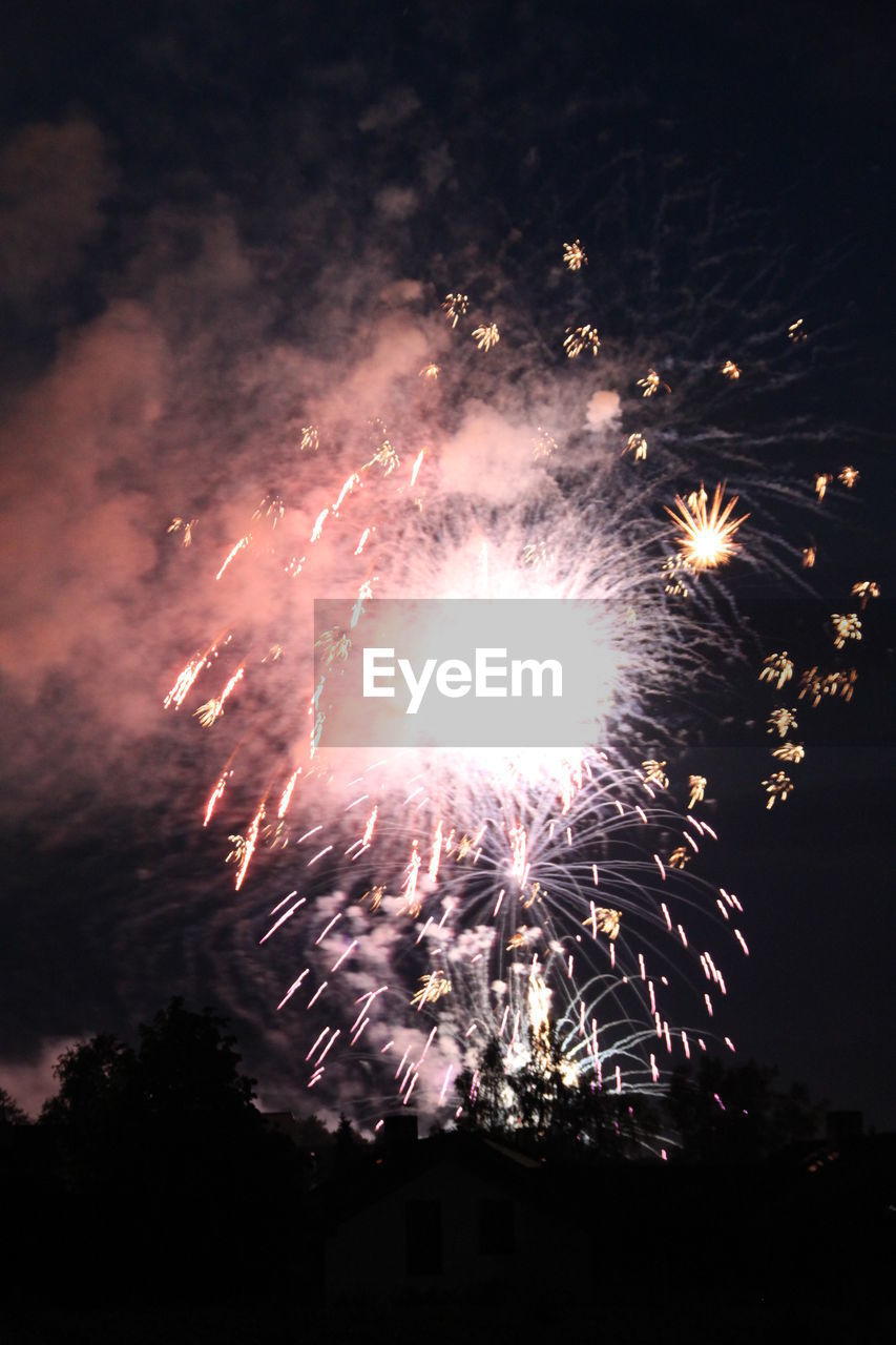 firework, celebration, event, night, firework display, exploding, motion, illuminated, arts culture and entertainment, long exposure, glowing, low angle view, sky, no people, firework - man made object, nature, smoke - physical structure, light, blurred motion, outdoors, sparks, explosive, bright