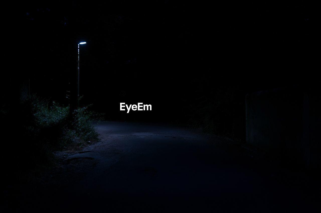 Illuminated Road At Night