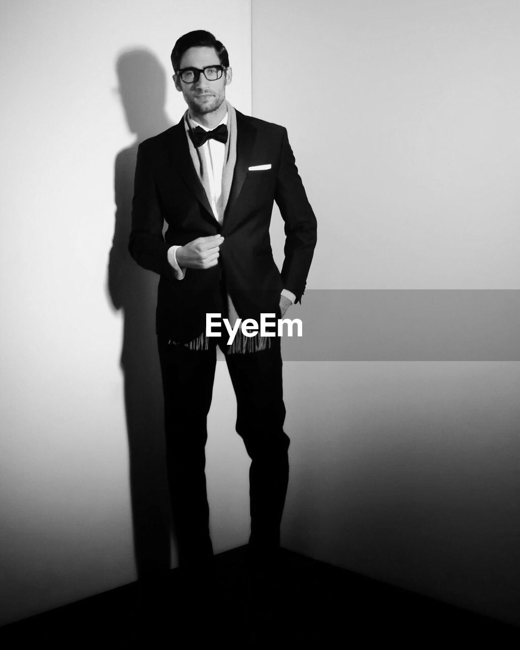 glasses, eyeglasses, portrait, indoors, looking at camera, well-dressed, standing, men, front view, business, young adult, wall - building feature, young men, one person, males, real people, office, suit, formalwear, fashion