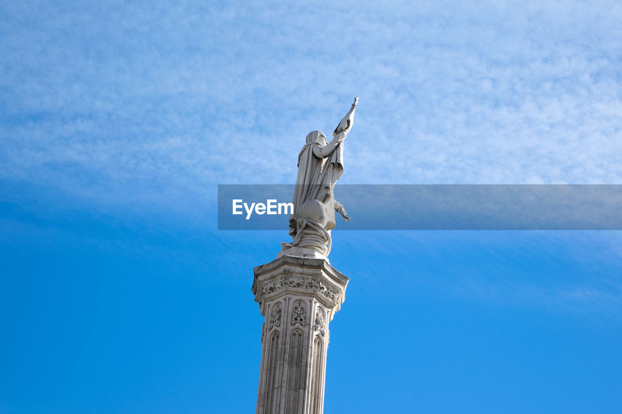 sculpture, statue, sky, representation, human representation, art and craft, low angle view, architecture, travel destinations, no people, nature, blue, creativity, travel, built structure, day, tourism, craft, religion, memorial, architectural column, angel, outdoors